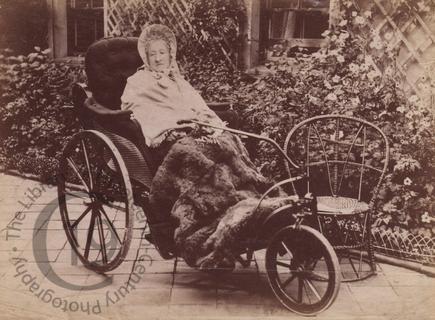 Elderly woman in a bath chair