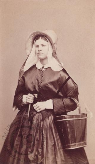 Belgian girl with umbrella and bucket