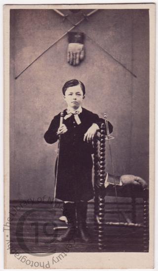 Boy with fencing foils