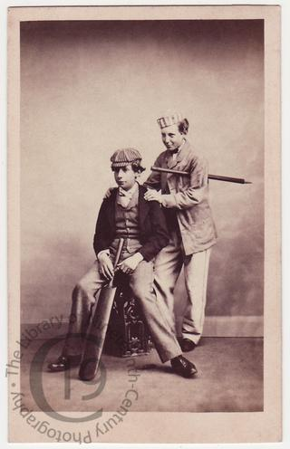 Two boys with cricket bats