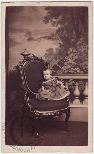 Small child on chair
