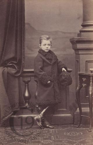 Unidentified boy in fur-lined coat