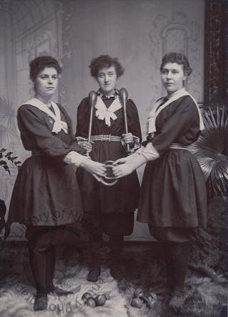Three women with exercise equipment