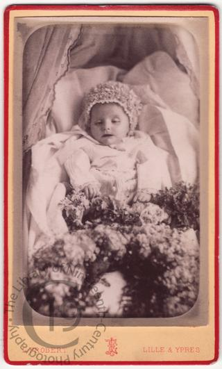 A baby with flowers
