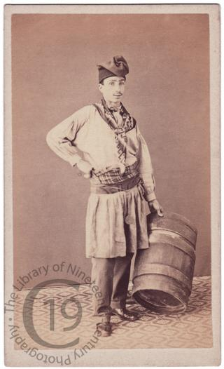 A workman with a barrel