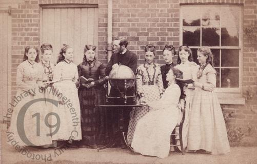 Man instructing young ladies