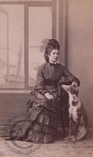 Young woman with greyhound