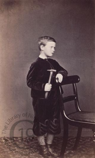 Unidentified boy with hammer