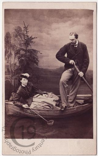 Couple in fake rowing boat