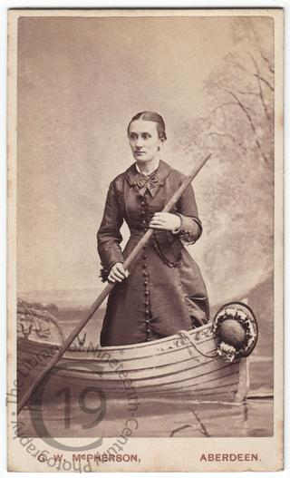 Woman in a fake rowing boat