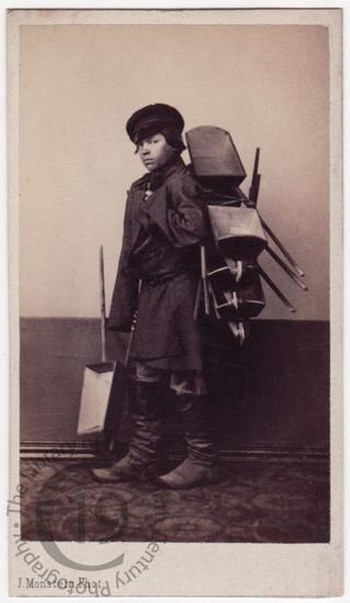 'Boy selling wheelbarrows'