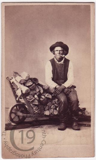 'Finnish sailor with barrow of firewood'