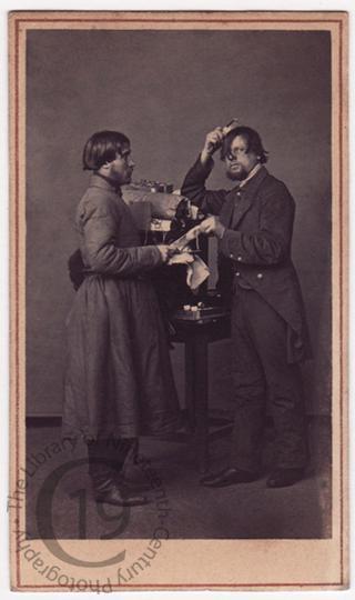 'Pedlar and manservant trying comb'