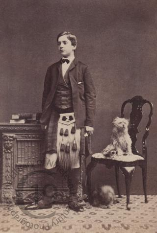 Young man in kilt