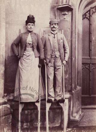 Unidentified couple on stilts