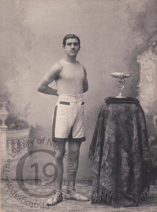 An athlete with his trophy