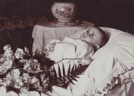 Baby with white flowers