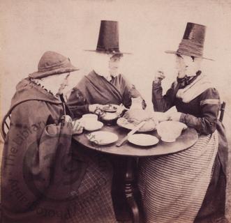 'Three old women at tea'