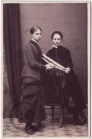 Two girls winding wool