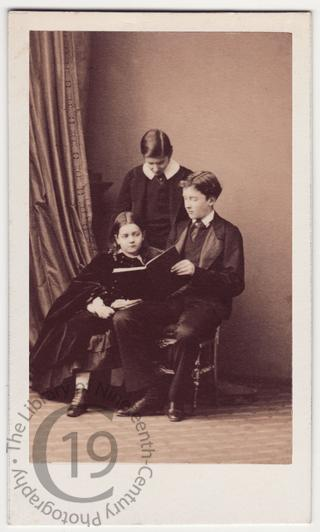 Three children with a book