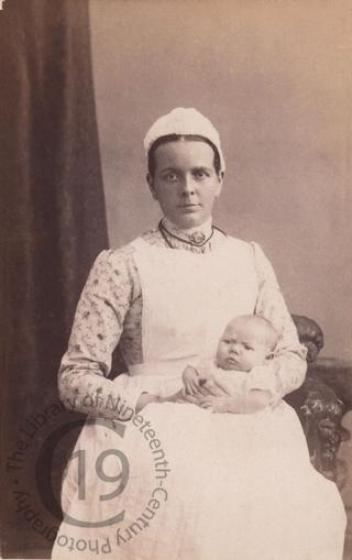 Unidentified nurse and baby