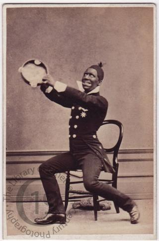 Blackface clown with tambourine
