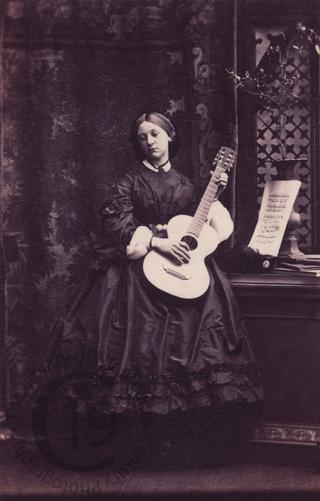 Miss Hoare with a guitar