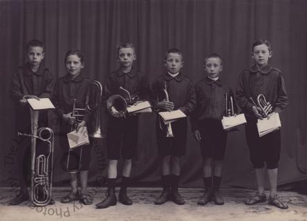 Danish schoolboys with brass instruments