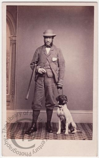 Man with dog and gun