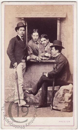 Four men with cigarettes
