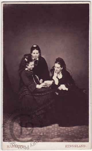 Three women reading a letter