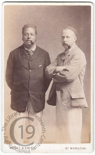 Two men smoking pipes