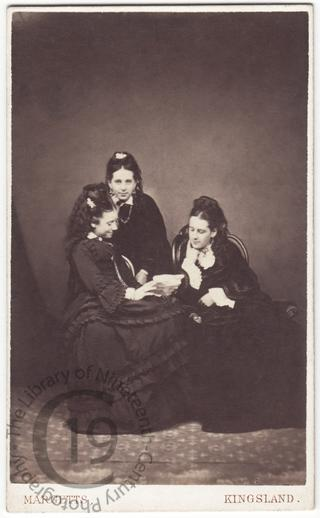 Three girls reading a letter