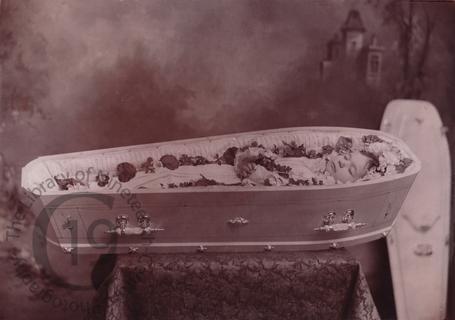 A child in a white coffin