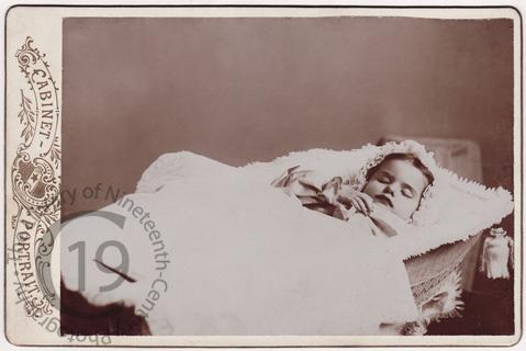 Child in Moses basket
