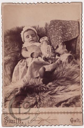 Small girl with doll