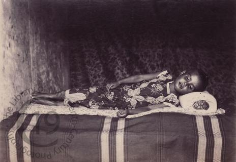 Burmese girl on a bed