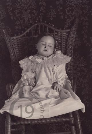 Young girl in wicker chair