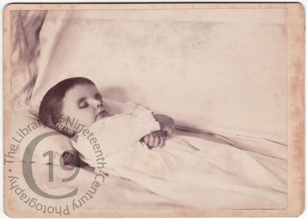 Boy with folded arms