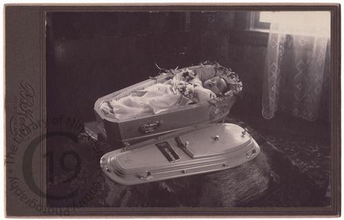 Baby in white coffin