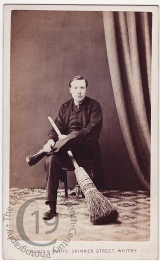 Young man with besom