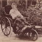 Elderly woman in a bath chair