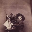 Boy with toy boat