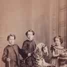 Three children with a rocking horse