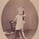 Child with tin bathtub
