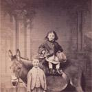 Two children with a donkey