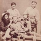 Four men drinking beer