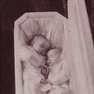 Twins in coffin