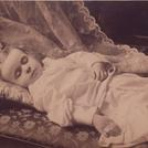 Child on cushions and sofa