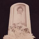 Woman in glass-topped coffin